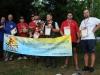 Фото победителей и призеров с рекламным баннером