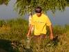 Дмитрий с водой для замешивания прикормки на тренировке сборной России по фидеру